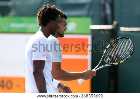 KEY BISCAYNE, FL-MAR 26: Jo-Wilfried Tsonga (R) and Gael Monfils of France during men's doubles on day four of the Miami Open at Crandon Park Tennis Center on March 26, 2015 in Key Biscayne, Florida. - stock photo