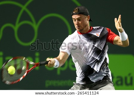 KEY BISCAYNE, FL-MAR 26: Lleyton Hewitt of Australia returns a shot during day four of the Miami Open at Crandon Park Tennis Center on March 26, 2015 in Key Biscayne, Florida - stock photo