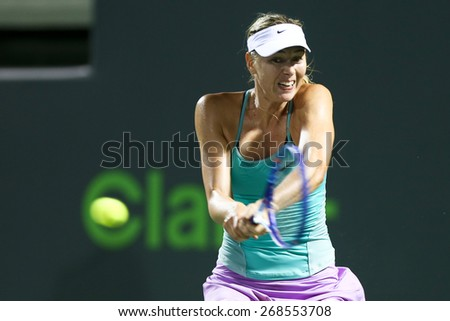 KEY BISCAYNE, FL-MAR 26: Maria Sharapova of Russia returns a shot during day four at the Miami Open at Crandon Park Tennis Center on March 26, 2015 in Key Biscayne, Florida. - stock photo