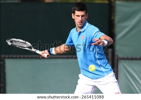KEY BISCAYNE, FL-MAR 27: Novak Djokovic of Serbia returns a shot from during day five of the Miami Open at Crandon Park Tennis Center on March 27, 2015 in Key Biscayne, Florida. - stock photo