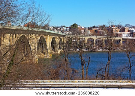 Key Bridge and a view on Georgetown suburb in winter, Washington DC. Key Bridge and Potomac River on a bright morning in winter. - stock photo