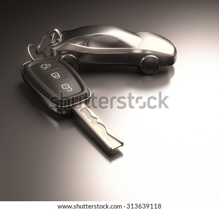 Key car and key ring over the metallic table. Clipping path included. - stock photo