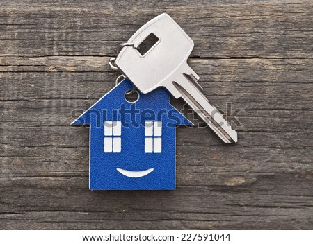 Key chain figure of house and key close up  - stock photo