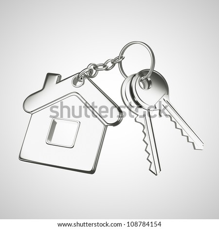 key chain with key in form of home - stock photo