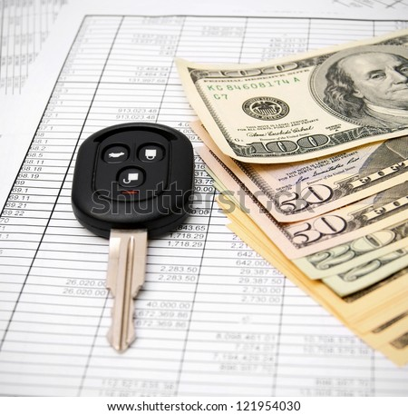 Key from the car and money on documents. - stock photo