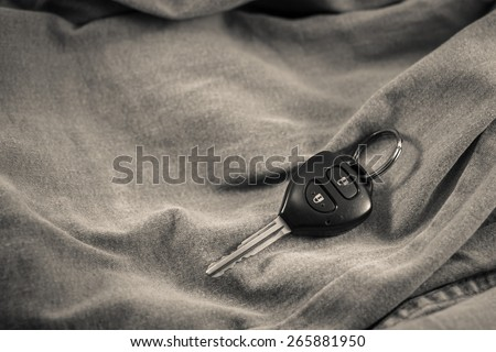 key from the car in the back pocket of jeans - stock photo