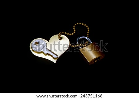 Key, heart,  lock - a symbol of love and devotion. Black background - stock photo