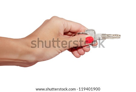 key in a female hand on a white background. Isolated.