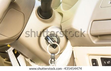 key in car lock - stock photo