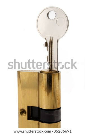 Key in cylinder lock - stock photo