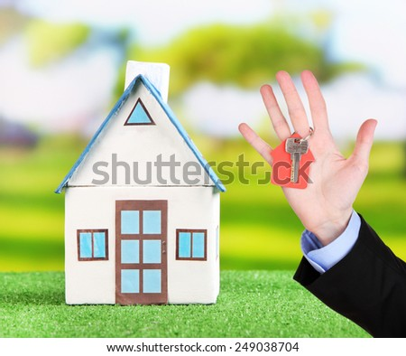 Key in hand and house model, Real estate concept - stock photo