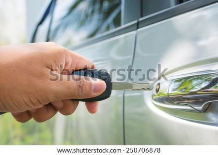 Key in hand is locking the door - stock photo