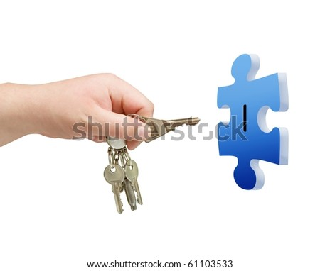 key in hand with puzzle isolated background - stock photo