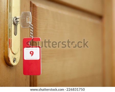 Key in hotel room's door  - stock photo