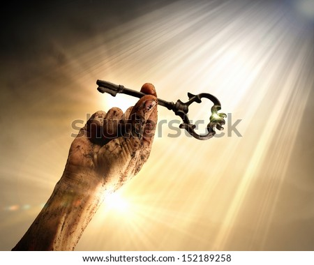 Key in human hand. Struggle and success - stock photo