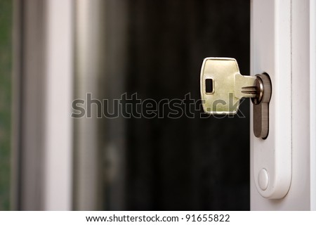 Key in keyhole - stock photo