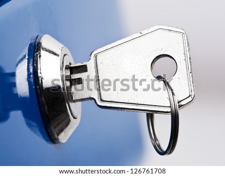 Key in lock, close up photo - stock photo