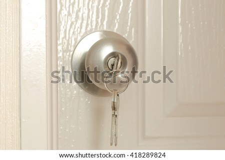 Key insert for unlock in stainless steel round ball door knob - stock photo