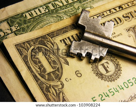 Key on a one dollar banknote - stock photo
