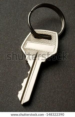 Key on the dark background - stock photo