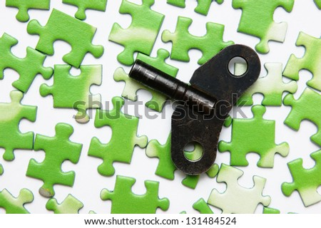 key on the green puzzle - stock photo