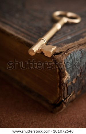 Key on vintage book - stock photo