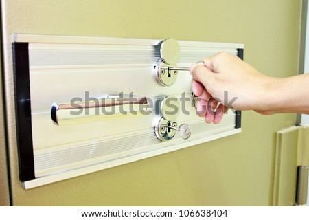 key opening green steel bank safe - stock photo