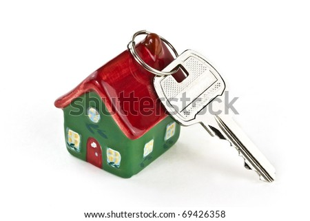 Key to new home isolated on white