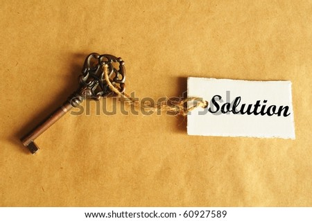 key to solution concept with old grunge label or tag - stock photo