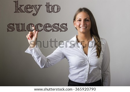 Key to Success - Beautiful girl touching text on transparent surface - horizontal image