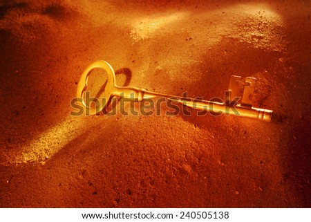 Key to success in sand - stock photo