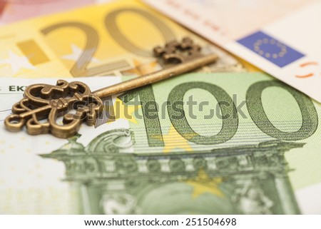 Key to success on different euro banknotes - stock photo