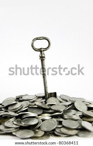 Key to success on hip of coins, isolated on white