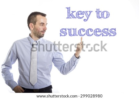 key to success Young businessman with small beard touching text
