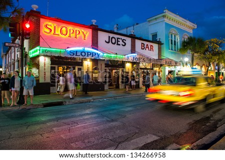 KEY WEST, FL - CIRCA 2012: View Slopppy Joe's Bar in Duval Street  a landmark in Key West circa 2012. The tropical city is a popular tourist destination with over 2 million yearly visitors. - stock photo