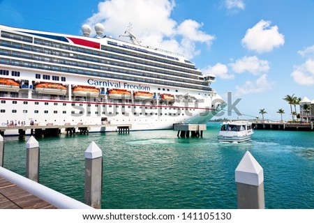 KEY WEST, FL - JULY 11:  Carnival's cruise ship, The Freedom, anchored in Key West, Florida on July 11, 2011. In 1984, the city improved Mallory Dock, making it a full cruise ship docking facility. - stock photo