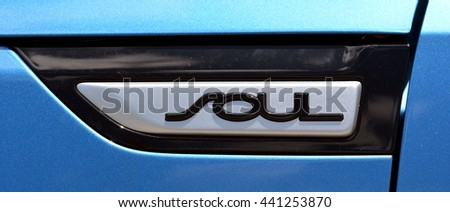 KEY WEST, FL.-JUNE 22:  A side emblem nameplate sign on a blue Kia Soul automobile on June 22,  2016, in Key West, Florida.  The Soul is a cross-over wagon manufactured in South Korea. - stock photo