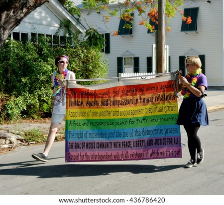 KEY WEST, FL-JUNE 12: People marching in the 2016 Key West Gay Pride parade carry a diversity gay rights banner on Sunday, June 12, 2016, in Key West, Florida. - stock photo
