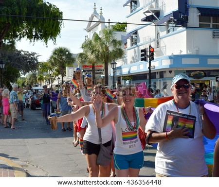 KEY WEST, FL-JUNE 12: People marching in the Key West Gay Pride parade carry a memorial banner honoring those killed in the terror attack at the nightclub in Orlando, Fl. on Sunday, June 12, 2016. - stock photo