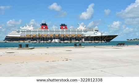 KEY WEST, FL.-OCTOBER 01: the Disney Magic, a Disney Cruise Line ship, docks in Key West, Fl., on October 01, 2015.  The cruise ship is 984 feet long and can accommodate up to 2400 passengers. - stock photo
