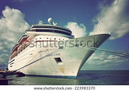 KEY WEST, FL.-OCTOBER 16:  the Majesty Of The Seas, a Royal Caribbean cruise ship, docks in Key West, Fl. on October 16, 2014, in this instagram style filtered vintage image. - stock photo
