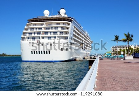 KEY WEST, FLORIDA-NOVEMBER 19:  Cruise Ship The World docks in Key West harbor, November 19, 2012.  Launched in 2002, she has 165 private onboard residences, and continually circumnavigates the globe. - stock photo
