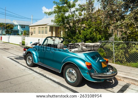 Key West, Florida USA - March 2, 2015: A classic Volkswagen Beetle convertible parked in the Bahama Village residential District of Key West. - stock photo