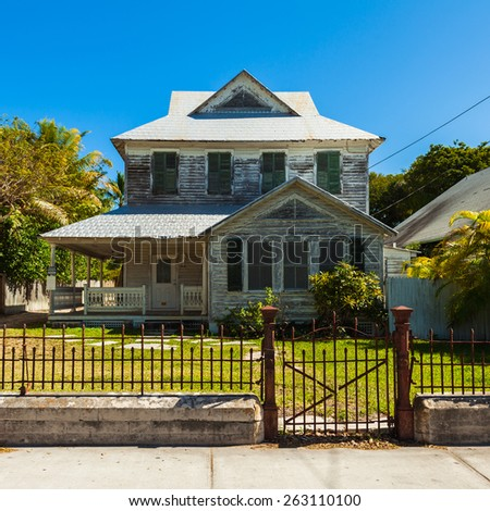 Key West, Florida USA - March 3, 2015: Typical wood frame architecture style home in the residential district of Key West. - stock photo