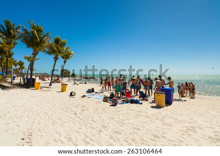Key West, Florida USA - March 3, 2015: Young college students enjoying spring break on a Key West beach in Florida. - stock photo