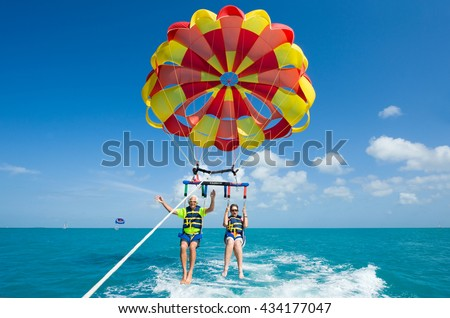 KEY WEST, FLORIDA, USA - MAY 02, 2016: An elderly couple is para sailing with a rope pulled by a boat near Key West in Florida