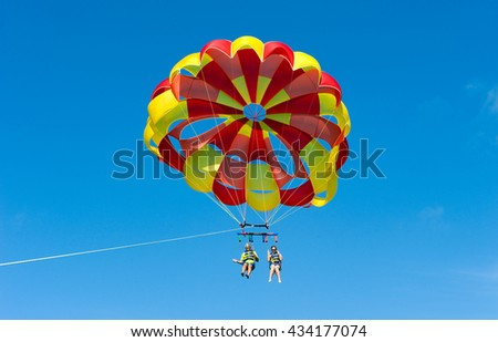 KEY WEST, FLORIDA, USA - MAY 02, 2016: An elderly couple is para sailing with a rope pulled by a boat near Key West in Florida - stock photo