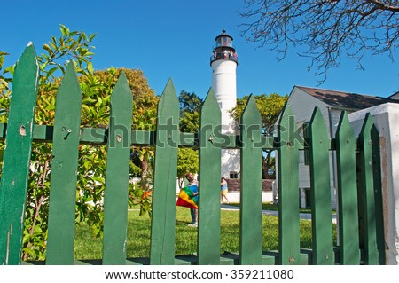 Key West Lighthouse, green fence, view, Keys, Cayo Hueso, Monroe County, island, State of Florida, Sunshine State, coast, Gulf of Mexico, Atlantic Ocean, United States of America - stock photo