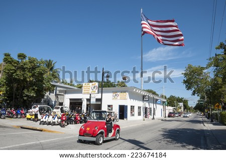 KEY WEST, USA - NOV 19: Tourists riding through the city of Key West in electric car. November 19, 2009 in Key West, Florida, USA - stock photo
