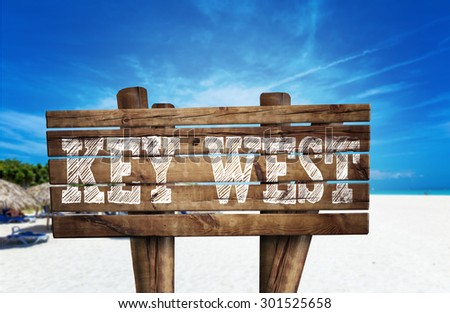 Key West wooden sign on the beach - stock photo